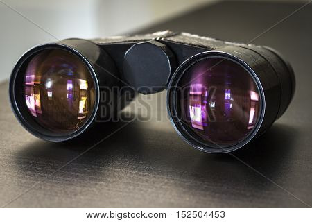 Opera glasses lying on the table close-up.