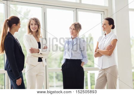 people, work and corporate concept - business women meeting at office and talking