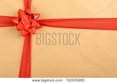 red bow and ribbon on paper texture