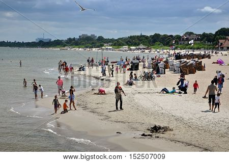 SOPOT, POLAND - JULY 15, 2013: The Baltic Sea and the sandy beach of Sopot with vacationers people on the background of stormy sky. Poland.