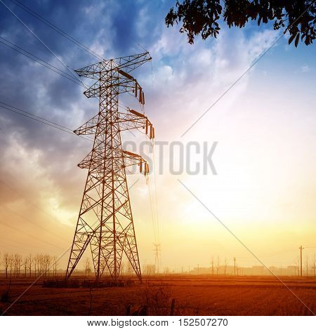 Erected on the ground of the giant tall high-voltage transmission tower.