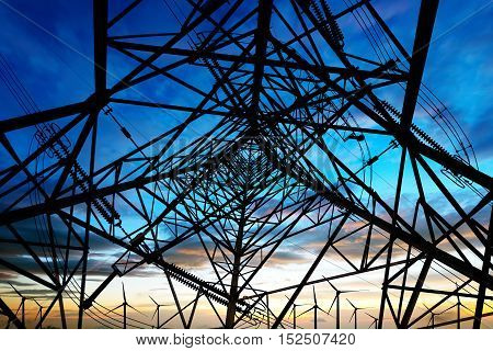 Giant tall high-voltage transmission tower steel structure.