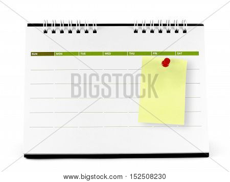yellow paper note with red thumbtack on blank calendar page isolated on white background