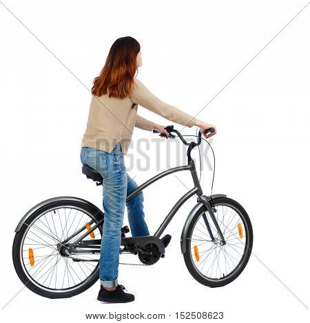 side view of a woman with a bicycle. cyclist sits on the bike. Rear view people collection.  backside view of person. Isolated over white background.