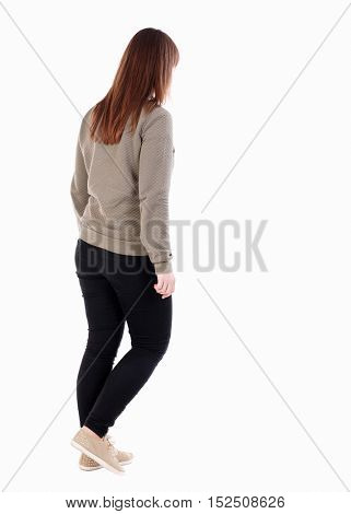 back view of walking  woman. beautiful girl in motion.  backside view of person.  Rear view people collection. Isolated over white background. Full girl in black tights out sideways.