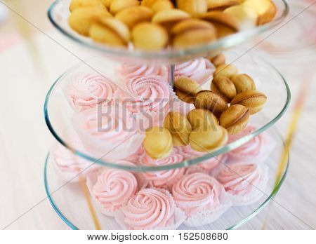 food, junk-food, culinary, holidays and eating concept - close up of sweet custard dessert and cookies on glass serving tray