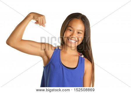 Cute Filipino Girl on a White background  wearing a tank top.  She is making a muscle and is smiling
