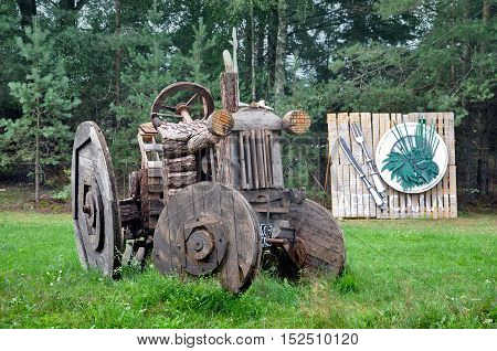 Porechie, Belarus - August 17, 2016: Art objects created from wooden spools in the Belorussian village of the Grodno region. Stylized tractor.