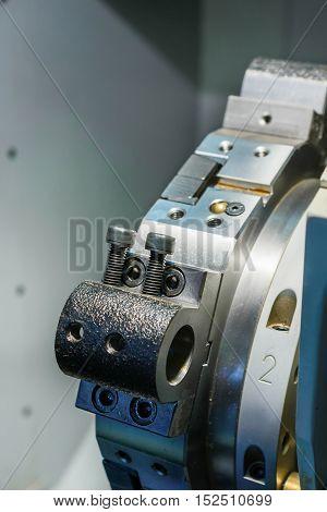 Enpty cnc lathe tool turret. Rotating head for tool change.