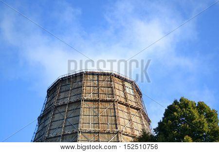 tube top with white smoke on a pure blue sky close