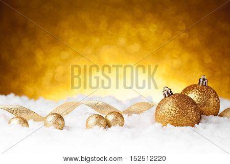 Golden christmas ball on glitter background. studio shot