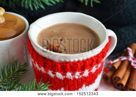 Winter hot drink - hot chocolate with cinnamon and anise on a white background