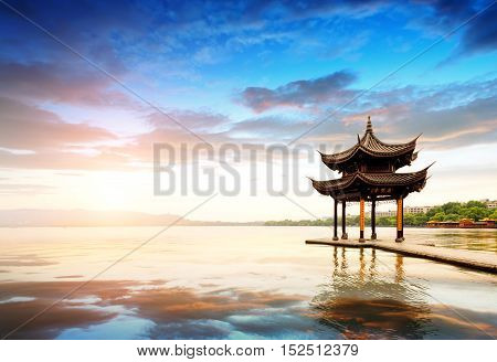 ancient pavilion in hangzhou with sunset glowChina