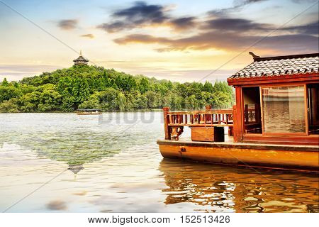 Traditional wooden row boat on famous West Lake Hangzhou China