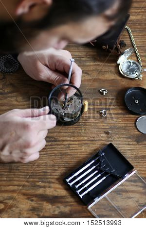 Workshop watch repair man in the course of work