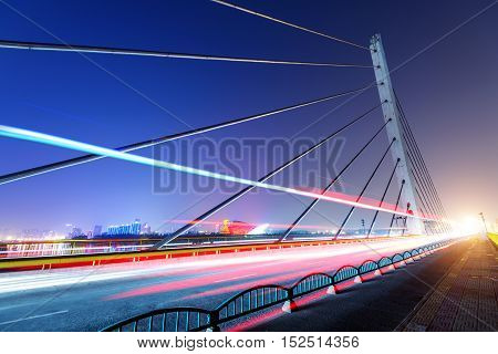 Bridge at night and the light track vehicles in Shanghai China.