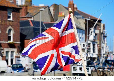 WEYMOUTH, UNITED KINGDOM - JULY 18, 2016 - Union Jack flag in the harbour Weymouth Dorset England UK Western Europe, July 18, 2016.