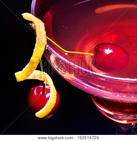 Part of cherry cocktail with lemon slice decoration in martini glass . Top view.
