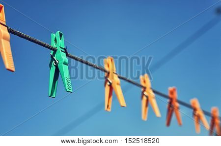 Drying laundry on a country house rope with clothespins on it