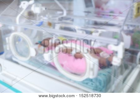 Newborn baby in hospital post-delivery room .