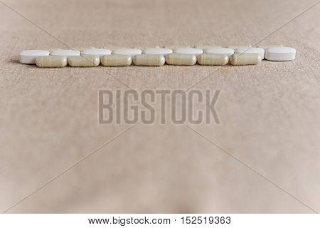 tablets and pills on a beige background disease treatment medicine