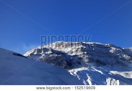 Snow Winter Mountains At Sun Windy Morning