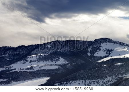 Winter Snow Mountains And Storm Clouds At Evening