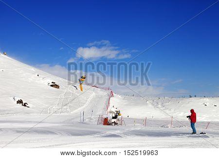Skier On Snow Ski Slope At Sun Day