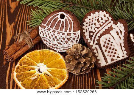 Christmas Gingerbread Cookies, Cinnamon And Orange Slice On Wooden Background