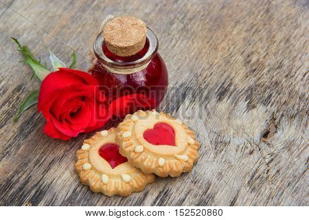 closeup, natural, rose, dessert, essential, sweet, herbal, elixir, day, red, aroma, flower, concept, wellness, magic, symbol, aromatic, perfume, gingerbread, cosmetic, christmas, essence, treatment, love, shape, biscuit, pink, bottle, therapy, healthy, ca