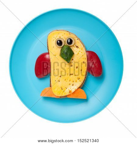 Penguin made of bread and cheese on plate
