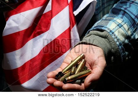cases from the military cartridges in the hands of the men of war concept