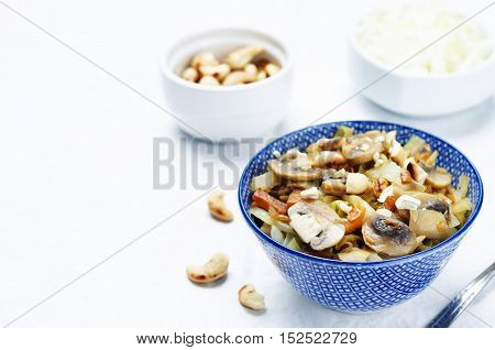 Delicious and healthy cashew cabbage with mushrooms.