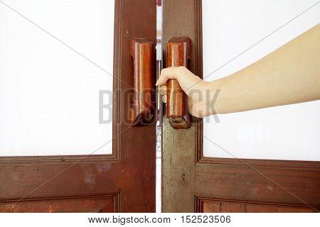 hold handle of wood door, entrance, room, wooden