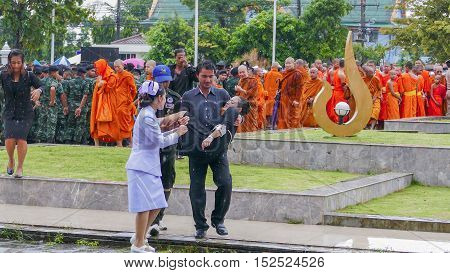 KRABI THAILAND - OCTOBER 19 2016: Thai woman faint during Mourning Ceremony of King Bhumibol Adulyadej at Krabi Provincial Hall on October 19 2016 in Krabi Thailand.
