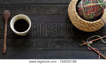 Knitted Background With Needle, Yarn, Coffee Cup