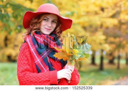 woman in a red hat autumn outdoor