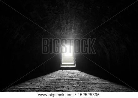 German medieval basement - Interior image with a medieval german wine cellar with its stone floor and the sunlight at the entrance