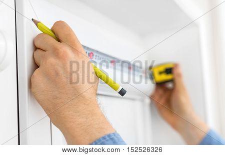 Man Installing Cassette Roller Blinds On Windows.