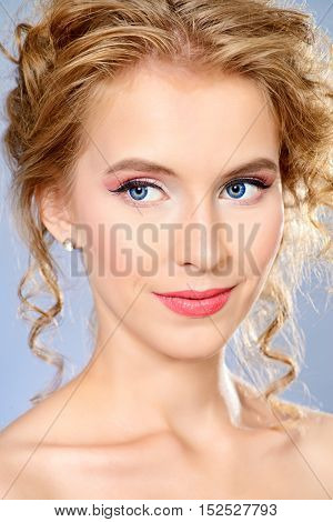 Spa woman. Beautiful smiling young woman with natural make-up and blonde curly hair. Summer, spring inspiration. Beauty, fashion, cosmetics. Copy space.