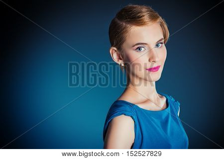 Portrait of a beautiful young woman with evening make-up and retro hairstyle. Fashion shot.