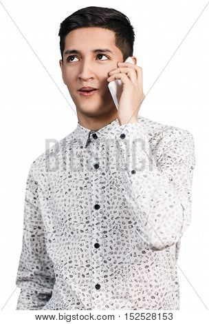 Portrait of young man talking on the phone isolated on white