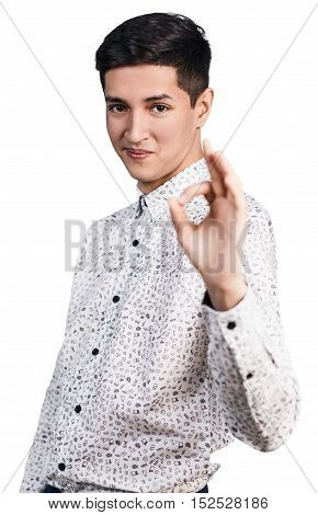Young handsome man shows OK sign isolated on white