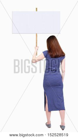 Back view woman showing sign board. man holds information plate. Rear view people collection. backside view person. Isolated over white. The brunette in blue dress holding a poster in his right hand