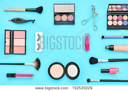 Fashion Cosmetic Makeup. Woman Beauty Accessories Set. Essentials. Makeup background. Fashion Design. Lipstick Brushes Eyeshadow, fashion Eyelashes. Minimal Concept. Top view. Cosmetic Overhead
