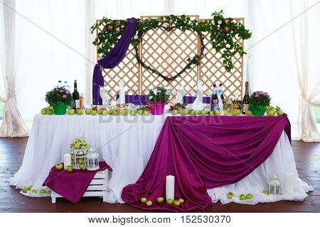 Saint Petersburg, Russia, September 4, 2016: wedding table decorated for a festive Banquet. Decoration verence for the newlyweds.