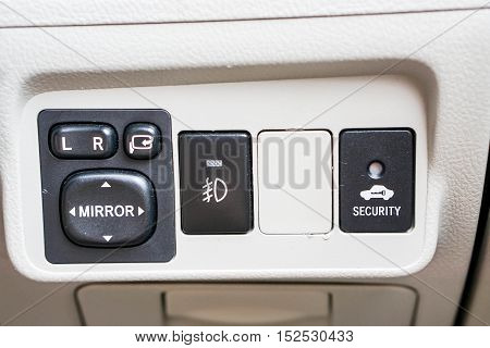 close up wing mirror personal car control panel