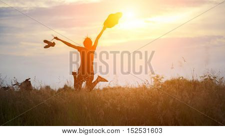 Yong woman in meadow. travel and sunset soft and select focus