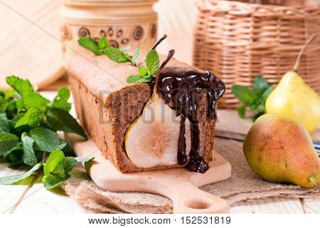 Chocolate cake with pears and chocolate sauce