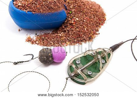 Dry Feed For Carp Fishing. Ready For Use Carp Bait With Fishing Flat Feeder For Carp Fishing Isolate